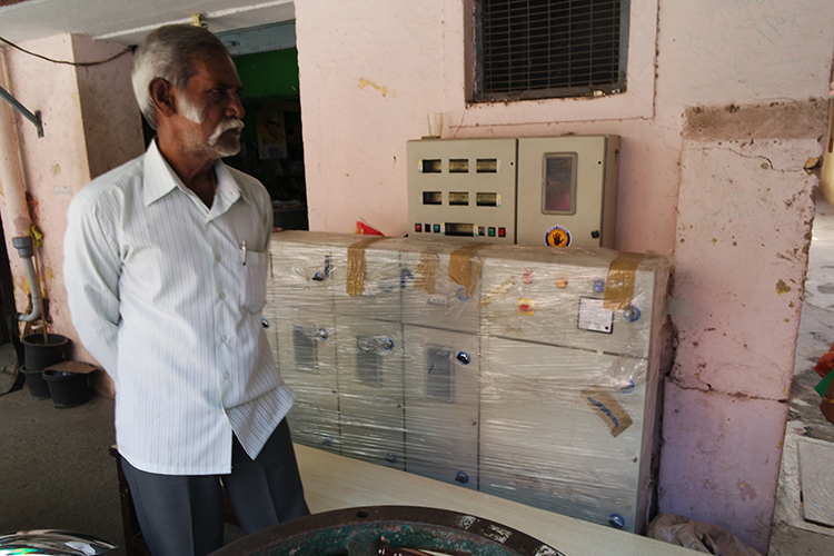 Pooni's father-in-law is an entrepreneur.  Here, he shows us samples of the electronic control boxes that his company builds.