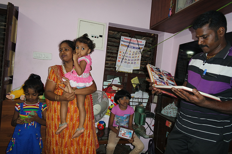 Pooni with her daughter, niece, and husband in her middle class apartment.