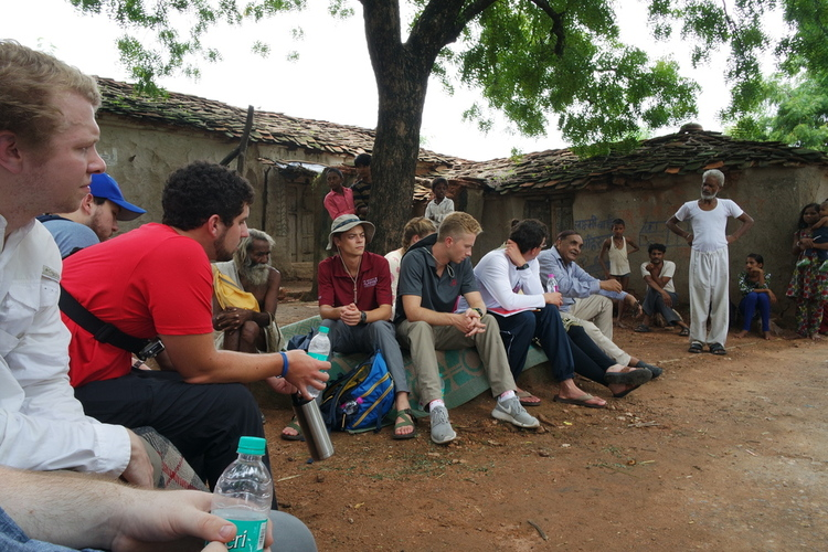 STEM MBA students engage in discussion with villagers in the small farming community of Mukarwa.